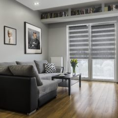 Grey sofa and coffe table in bright apartment relaxing space
